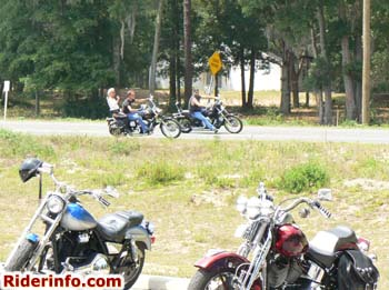 Bikers riding motorcycles on a poker run.